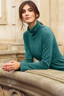 Roll neck nursing top in wool, on location