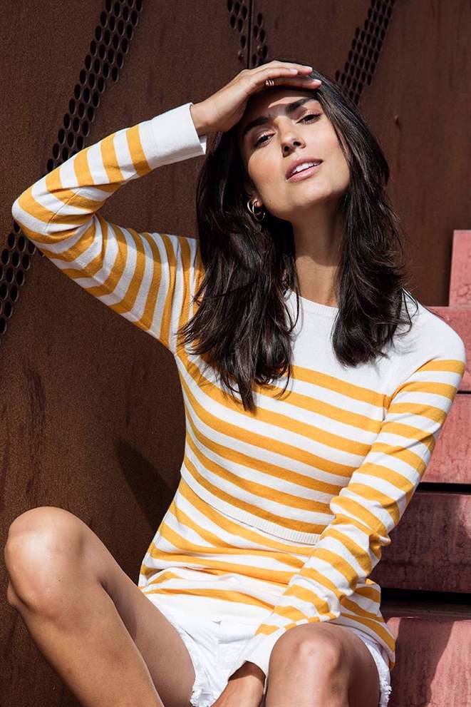 Coral/yellow striped nursing blouse in organic cotton knit - a casual pose in the sun