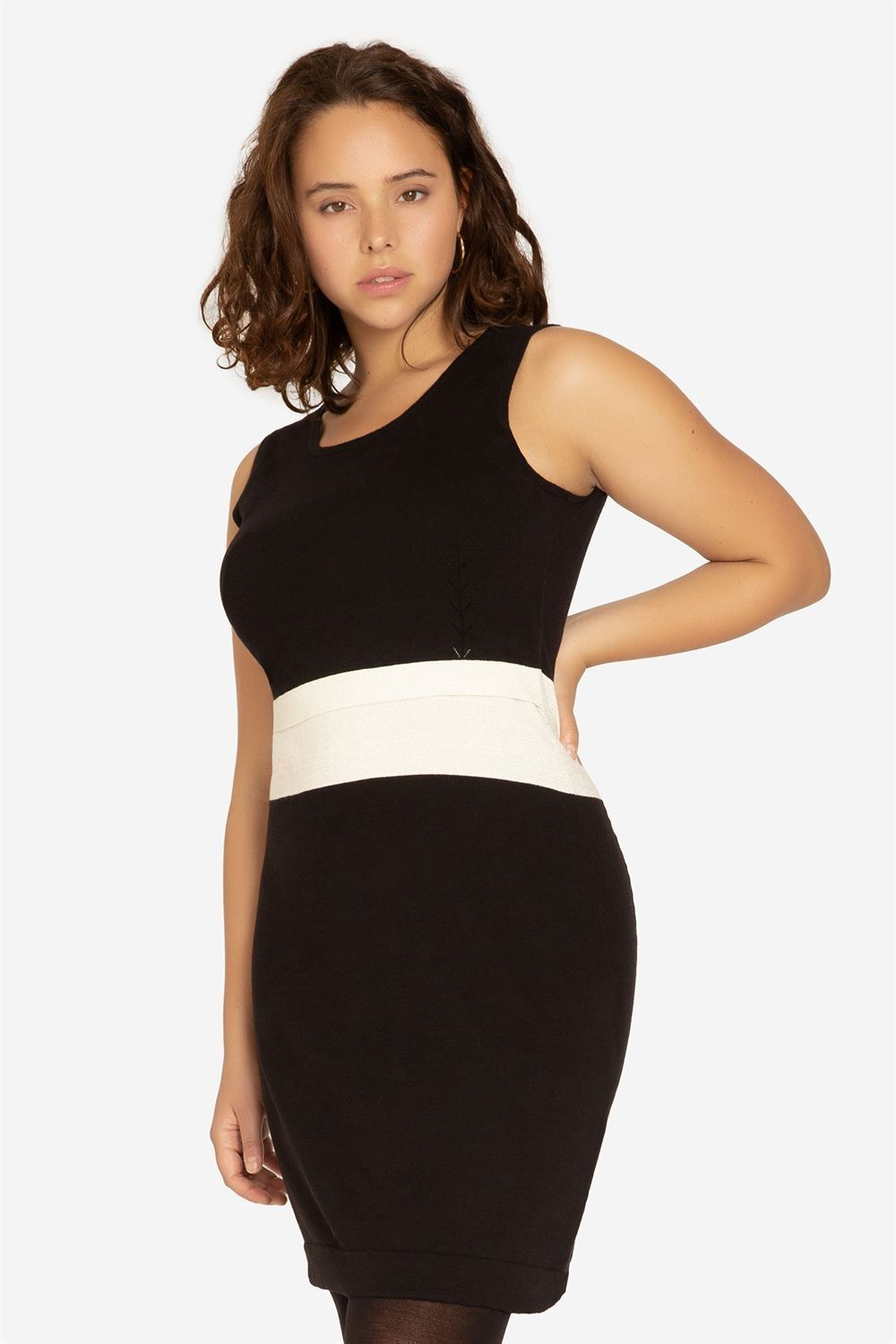 Black nursing dress with slim white waistline - a figure shot