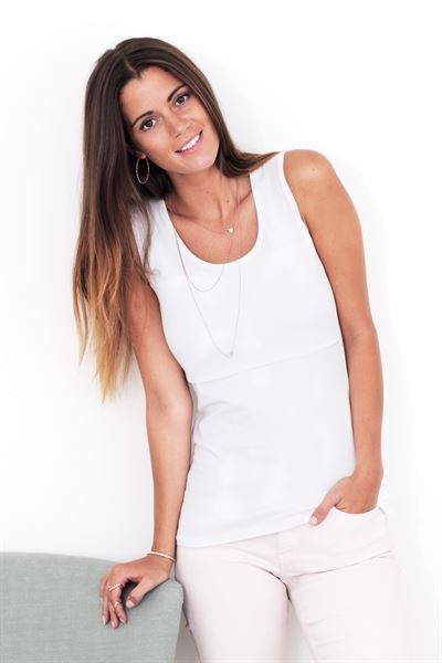 White nursing top with a deep round neck and wide straps - On location