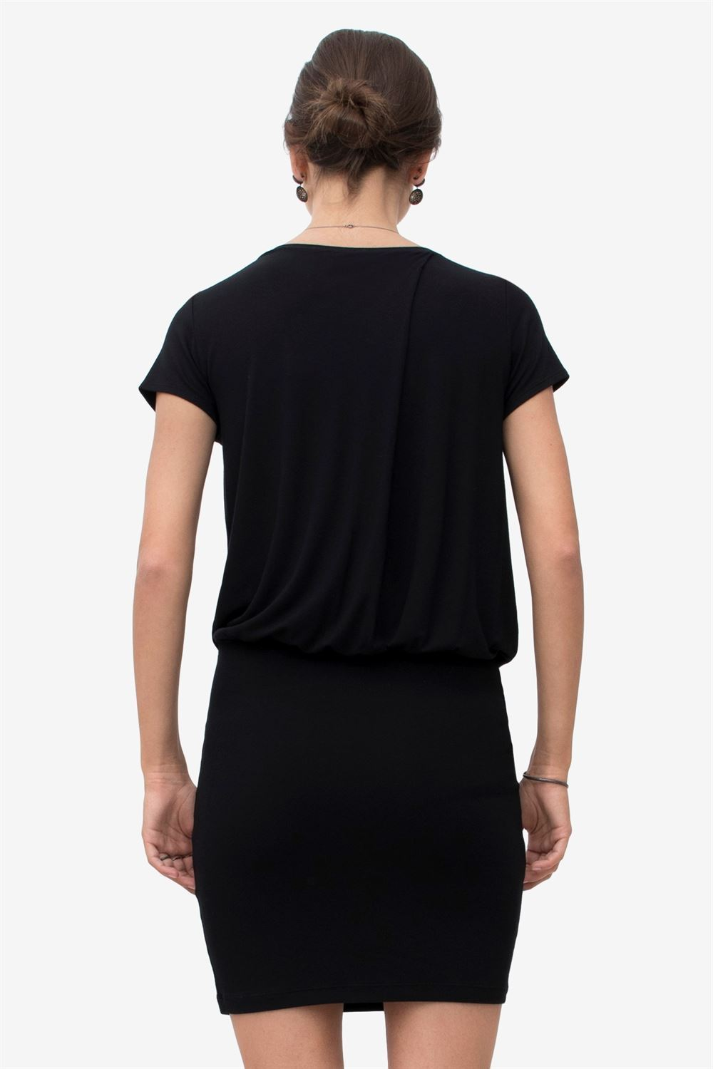 Black nursing dress with loose top and tight skirt - seen from behind