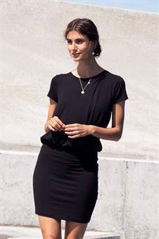 Black nursing dress with loose top and tight skirt - on location