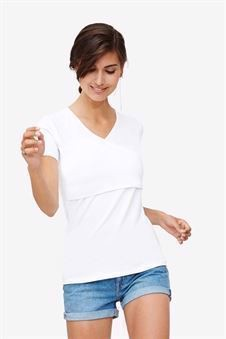 White nursing top with V-neck and wrap-around look - in motion